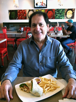 Enrique Lombrozo with Luna Grill's Chipotle Chicken Wrap