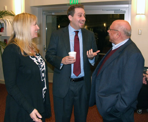 Tammy Gillies, San Diego regional director of the Anti-Defamation League, and her retired predecessor in that office, Morris Casuto, right, share a laugh with Oren Segal, ADL's national research director