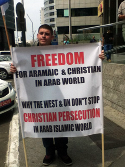 Christian Arab sign carrier
