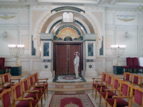 Roberta Greene stands at the aron kodesh in Casablanca synagogue