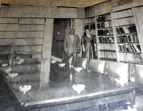 Mr. and Mrs. Samuel Perlmutter stand in the Center library whose furnishings they donated. Shelves will be filled by libraries donated by Hyman Wolf of Dr. and Mrs. A.P. Nasatir, and Mr. and Mrs. Albert Hutler in memory of Louis and Ossie Ehrlich.