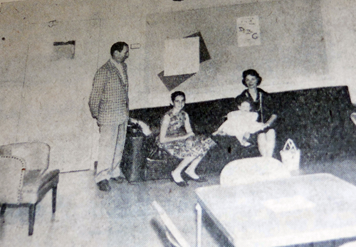 The Sidney Rose family sit in the Club Room which they donated to the JCC. Mr. Rose was Building Committee Chairman.