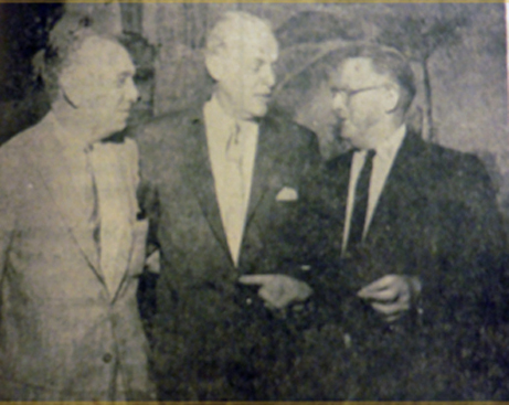 Maxwell Kaufman, candidate for Assembly in the 79th District, meeting with Paul Butler, National Chairman of the Democratic Party. Mr. Butler urged all Democrats to vote for Mr. Kaufman in the June 3 Primary. Standing with them is G.K. Williams, chairman of the Democratic County Central Committee.