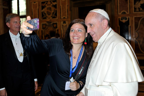 Official photographer takes photo of Jenn's selfie with Pope Francis (Photo: L'Osservatore Romano.)