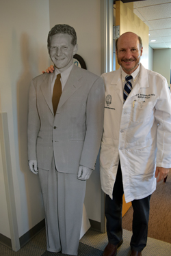 Dr. Paul Bernstein, right, with standup poster of Dr. Sidney Garfield