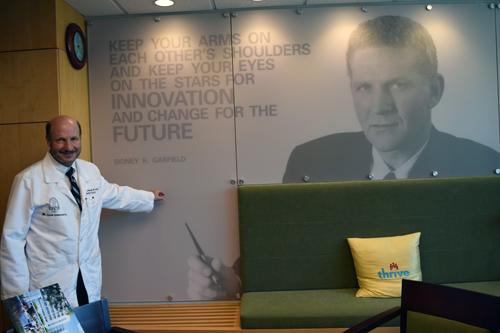 Dr. Paul Bernstein with Garfield mural in his Kaiser-Permanente office