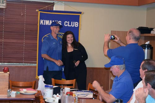 Bruce Chase, president of Fletcher Hills Kiwanis Club, welcomes Jenn Lindsay home from Rome