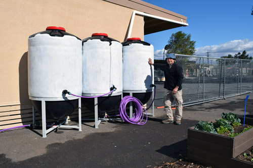 Rain Barrel System now in use at Franklin Elementary School catches roof runoff water and stores it for garden irrigation
