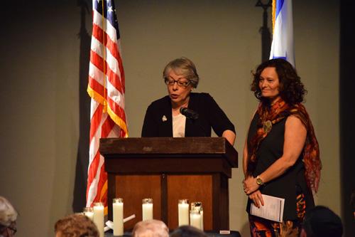 Jan Landau at lectern with Cheryl Rattner Price beside her