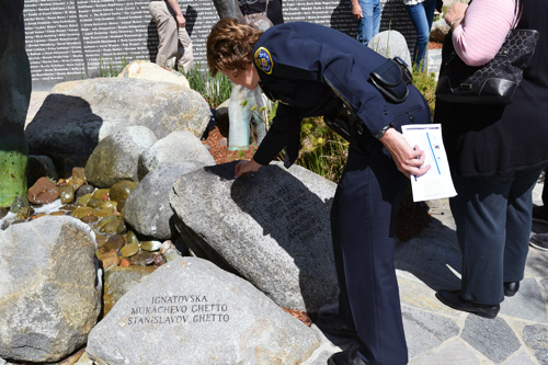 San Diego Police Chief Shelley Zimmerman places a stone at the Holocaust Remembrance Garden