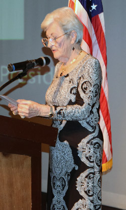 Rose Schindler, president of the New Life Club, was among three named by Union Bank and KPBS as Jewish heroes.  She is shown speaking at the Holocaust commemoration held Sunday, May 1, at the Lawrence Family JCC (SDJW photo by Shor Masori)