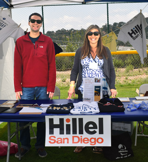 Aaron Levin-Fay and Jennifer Paul showcased clothing items and information flyers at the Hillel booth