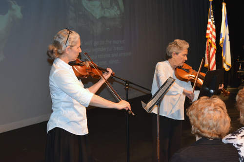 """Myla Wingard, left, with mother Eileen Wingard perform """"Raisins and Almonds."""""""