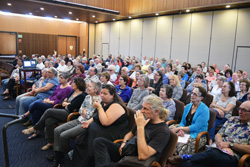 A portion of the crowd at Temple Emanu-El for Joellyn Zollman's deli lecture. Rabbi Devorah Marcus, front row, second from right, looks at the camera.