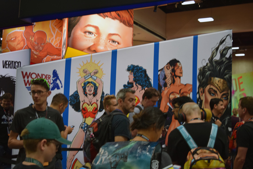 Alfred E Neuman looks over Wonder Woman who is celebrating her 75th anniversary
