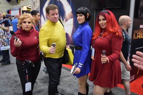 Four attendees dressed as the crew of the Starship Enterprise, including a gender-bent Spock