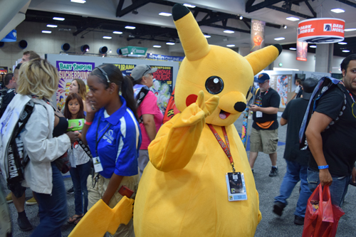 A Pikachu giving a peace sign and trying not to be caught by ambitious trainers.