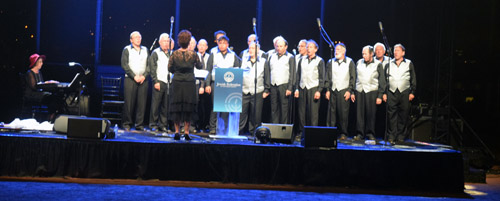 The San Diego Jewish Men's Choir entertained during the outdoor barbecue dinner on the football field of San Diego Jewish Academy.