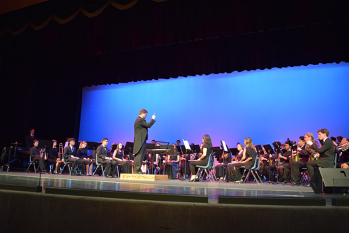 Matthew Kallal conducts the PHHS Band in very first performance at PHAME (Photo: Shor Masori)