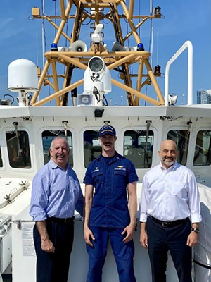 Rabbi Irving A. Elson, Capt., CHC, USN (Ret), vice president of JWB Jewish Chaplains Council (left); Lt. Andrew Corwell, Commanding Officer USCGC Nathan Bruckenthal (WPC 1128); Doron Krakow, president and CEO of the JCC Association of North America.